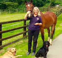Christine with horse and dogs